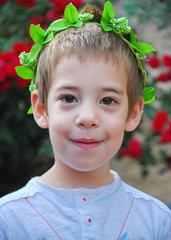 Young boy with a crown of leaves