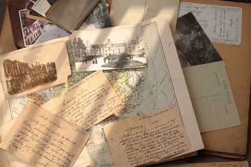 Old postcards, letters and atlas.