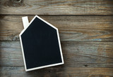House Shaped Chalkboard sign  on rustic wood with place for text