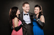 Love triangle. Two laughing women and man. Fun.