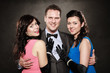 Love triangle. Two smiling women and man. Fun.