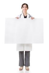 doctor woman holding blank board