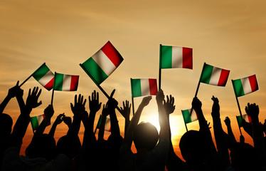 Group of People Waving Italian Flags in Back Lit