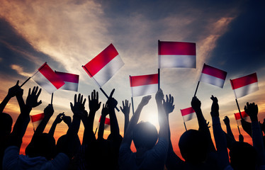 Silhouettes of People Holding the Flag of Indonesia