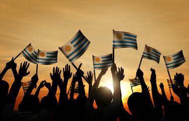 Group of People Waving Uruguayan Flags in Back Lit