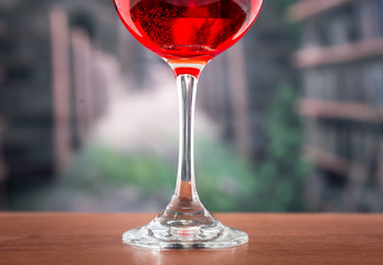 glass with red liquid cocktail