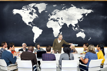 Group of People in a Meeting and World Map