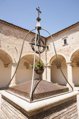 Waterwell center, Italian courtyard surrounded by portico.