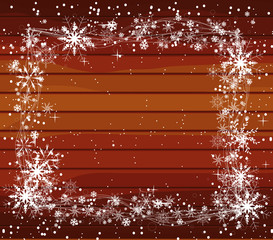 christmas background with snowflakes on wood
