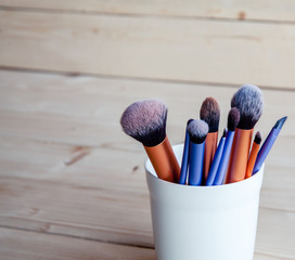 Make up tools on a wooden background