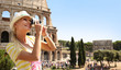 Happy Tourist and Coliseum, Rome. Cheerful Young Blonde Woman