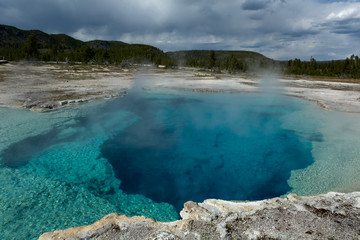 steamy blue post-volcanic pool in Yellowstone