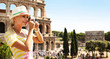 Happy Tourist and Coliseum, Rome. Cheerful Young Blonde