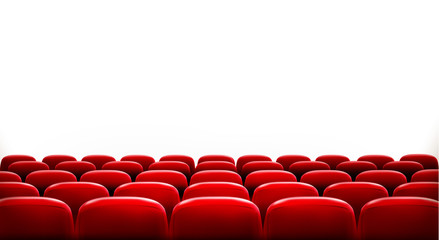 Rows of red cinema or theater seats in front of white blank scre