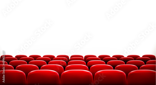 Rows of red cinema or theater seats in front of white blank scre - 69965327