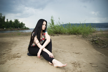 Beautiful young woman on a sandy beach