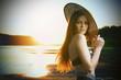 Beautiful woman in bikini on sunset background