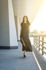 Photo of lady in elegant evening dress. With sunshine effect.