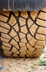 The tire on a dirt road