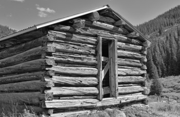 Old log cabin in an abandoned mining town, Western USA