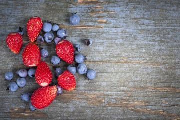 Wild berries on wood background
