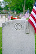 military dog tags on veteran's grave