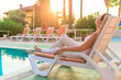 woman sunbathing on a sun lounger in the morning sun