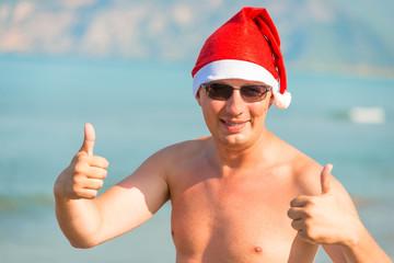 happy santa claus on vacation at sea