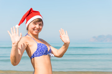 portrait of a girl in a cap of Santa Claus