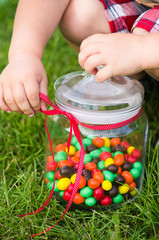 Child's hands with a candy jar