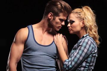 woman holding her hands on her boyfriend shoulder