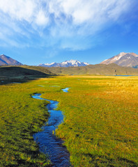 Crosses the picturesque valley of the creek