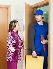 Middle-aged housewife meeting smiling worker