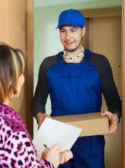 Postman in uniform delivered box