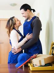 Repairman and woman having flirt