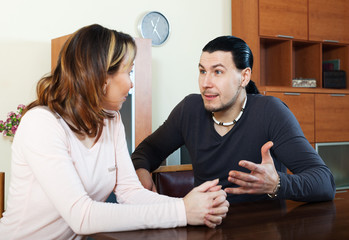 Casual couple having serious talking
