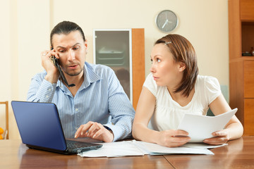 couple calling by mobile about  documents