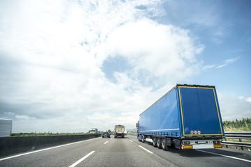 Blue truck in highway
