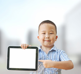 Asian boy 6 years with tablet computer