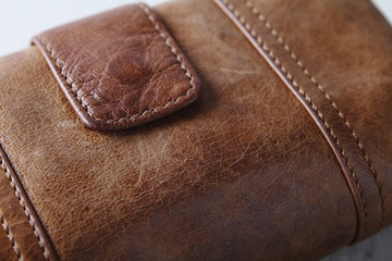 Brown leather purse wallet close up