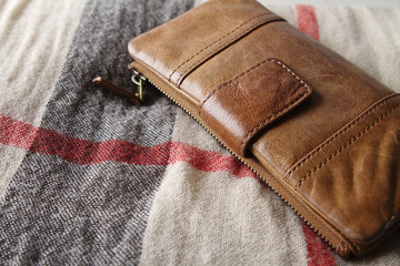Brown leather purse on a hessian fabric