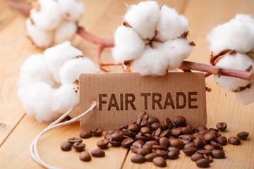 Fair Trade - Handel - Schild mit Baumwolle und Kaffee
