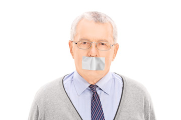 Portrait of a senior with a duct taped mouth