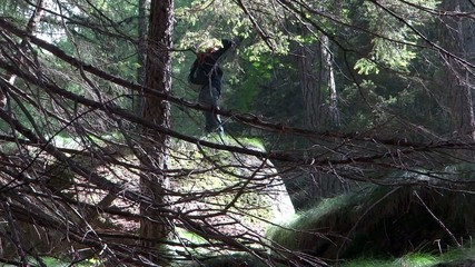 woman hiking in a wild forest