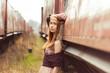 beautiful hippie girl stands near the old car near