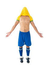 Full length of fit football player cheering