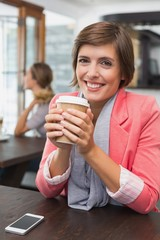 Pretty brunette enjoying her coffee