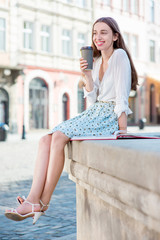 A businesswoman with cup of coffee to go