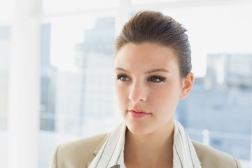 Pretty businesswoman looking and thinking