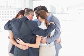 Business team all huddled together